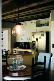 allen and roth pendant light b86050 a large pendant lighting above dining furniture black wood chairs allen and roth