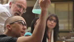 a college professor helps students understand a chemistry  a college professor helps students understand a chemistry experiment stock footage video 4746023 shutterstock