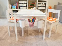 chic playroom featuring ikea expedit shelving unit filled with the container rugby stripe bins toys and books