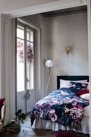navy bedding with beautiful pink flowers on it