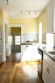 kitchen color scheme: Pale Yellow, Grey, White