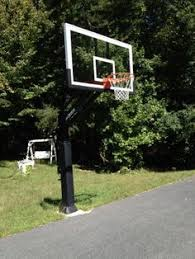 pro dunk hoops. This Fully Adjustable Pro Dunk Gold Basketball Stands Tall Over Playing Area. Trees Surround The Connecticut Backyard It Resides In. | Hoops