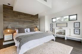 View in gallery Bedside pendants and accent oak wall accentuate the minimal  appeal of the room