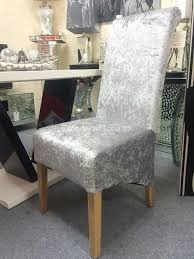 a gorgeous pair of stunning dining chairs finished in a smooth silver crushed velvet material and