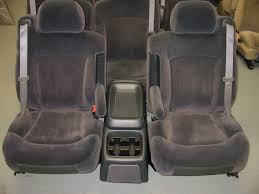 leather seats colors tan dark gray shale lt gray armrests are on the seat comes with lid type console but will fit jump seat