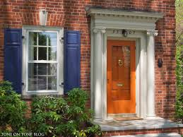 modern security screen doors. Beautiful Wood Andersen Storm Doors With Double Hung Windows And Red Brick Walls Modern Security Screen