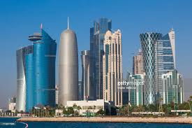 baywest city green office building. qatar doha bay west city skyline on sunny day baywest green office building