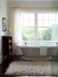 freestanding deep soaking tub. innovative flokati rug in bathroom transitional with freestanding tub wall mount filler next to deep soaking