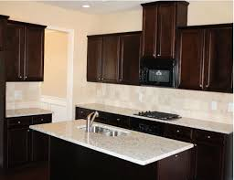 image of maple dark cabinets light countertops