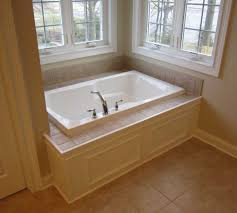 bathtub reglazing philadelphia luxury master bathtub custom paneled front with tile tub deck the norabathtub reglazing