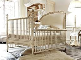 design interior and cream colored crib with patterned legs and wooden floor material with wool white area rug plus white window classic winnie the pooh