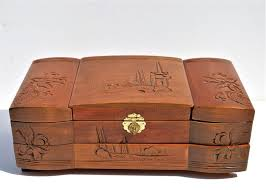 large wooden jewellery box with oriental decorations