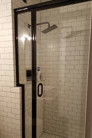 century lucette framed shower door panel in black finish in a vintage downtown chicago residence