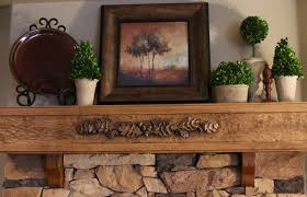 home was a hand carved wood fireplace mantel this treasured piece with relief sculptures of oak leaves and acorns gives the feel of a mountain lodge to
