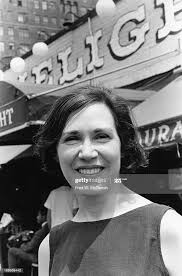 Portrait of art gallery owner Helen Gee as she poses in front of ...