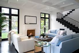 living room in a spanish revival home with light blue sofas white armchairs dark black white home office cococozy 5