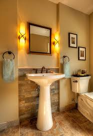 powder room bathroom lighting ideas. I Like The Sleek Pedestal Sink With Brick Accent Wall And Soothing Lighting In This Traditional Powder Room Bathroom By Wallner Builders Ideas H