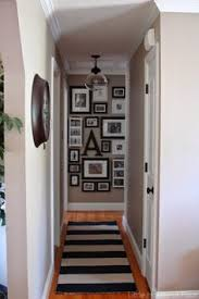a striped rug black and white gallery wall and updated light fixture spruce up an