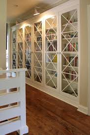 bookcase lighting ideas. fair billy bookcase closet decor ideas in family room transitional design with accent lighting baseboard beige walls book shelves crown molding