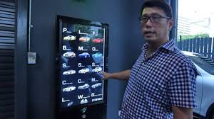 Vending Machine Dubai Fascinating Singapore Car 'vending Machine' Dispenses With Tradition GulfNews