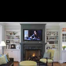 built ins next to fireplace tv darker color around fireplace