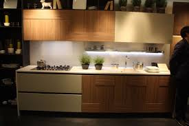 arcari s mix of wood kitchen cabinets in a natural color and beige cabinetry adds interest
