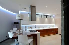 modern kitchen design trends 2016 with recessed light above sink and mini bar table with stools also using latest white cabinet ideas