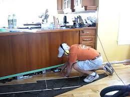 cutting kitchen cabinets. Pageau Renovation 2010 Day 02-2 Claude Cutting Flooring Under Cabinet Kick Kitchen Cabinets P