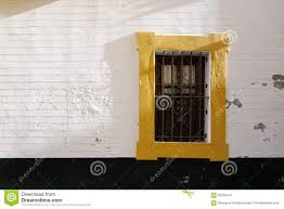 yellow paint window frame on the white wall