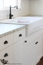 white bathroom cabinets with bronze hardware. fixer upper update: cabinet hardware | white cabinets, wood grain and oil rubbed bronze bathroom cabinets with b