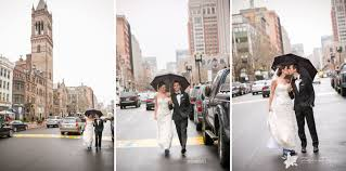 bride and groom first look walking on boylston street on a rainy day kissing under