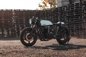 the donor bike was a 76 cb750f supersport and the end result delivers a rear wheel 67 horses all wrapped up in a fully road legal package replete with
