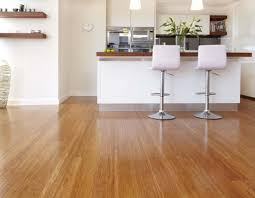 bamboo flooring in a small white kitchen