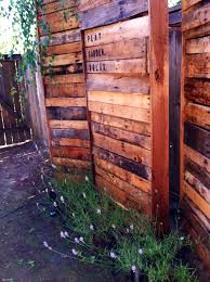 DIY Pallet Privacy Fence from recycled and upcycled reclaimed wood pallets