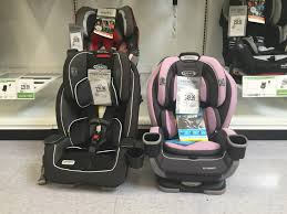 the graco milestone left and extend2fit 3 in 1 right side by side in at babies r us