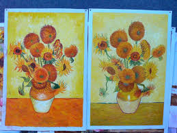 copies of sunflowers by zhao xiaoyong left and by another painter in