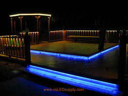 outside deck lighting. rgb flexible led strips lighting up an outside deck changing colors we are using white