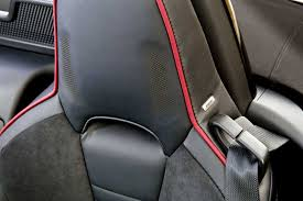 more than a detail the powerful bose speakers are integrated in the headrest of