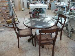 simple idea of glass dining table base with round glass table connected by brown wood chairs