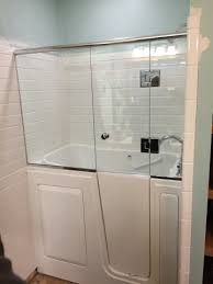 shower door installed onto a walk in tub