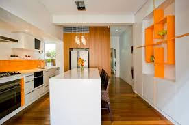 Probably the best room to use orange in and immediately achieve a  contemporary look, is the kitchen. Splash back areas in orange, set against  gray and ...
