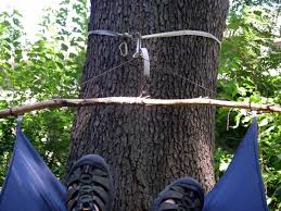 i have found you can lash branches picked up on the trail to the hammock corner rings such as