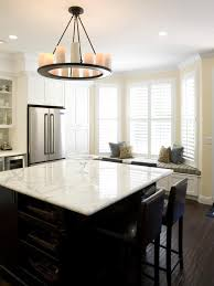 kitchen island with storage and seating large bay window bench feat square marble top small chandeliers