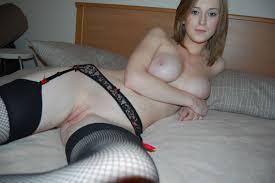 Amateur Shaved Brunette Girlfriend Wearing Stockings Image.