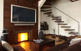 amazing floating staircase set beside brown living room seating area plus custom glass fireplace screen under tv wall