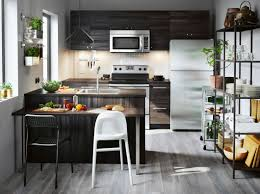 ikea kitchen image a small kitchen with black wood effect drawers doors and open storage