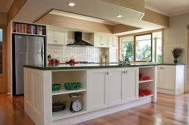kitchen backsplash ideas with white cabinets brown island table over antique chandelier complete creamy marble countertop island table white pad seat brown