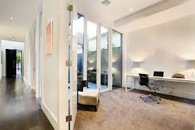 cool interior home office ideas with glass wall combine wooden frame also swivel chairs plus long white office table
