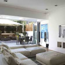 designing a living room space. open-plan living room with white walls, bi-folding doors, neutral corner designing a space