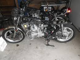 cx rescued cafe conversion a hacked up wiring harness and two bent wheels 2into1 exhaust and drag bars the other i was told lost the timing chain neither of which had any body